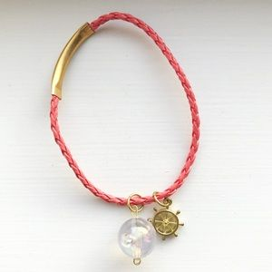 Coral braided leather ship's wheel charm bracelet